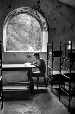Andre Kertesz, young man reading