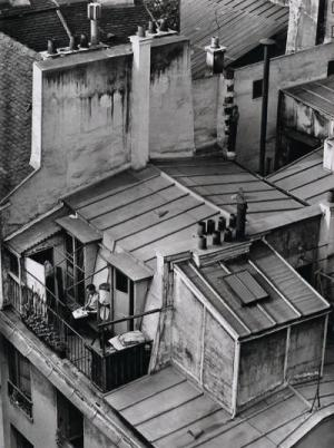 From André Kertész' series, On Reading. Latin Quarter, Paris