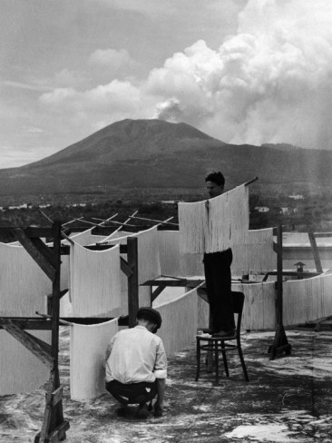 Alfred Eisenstaedt, View of Mt Vesuvius from the Town of Torre Annunciata with Men Tending to Drying Pasta